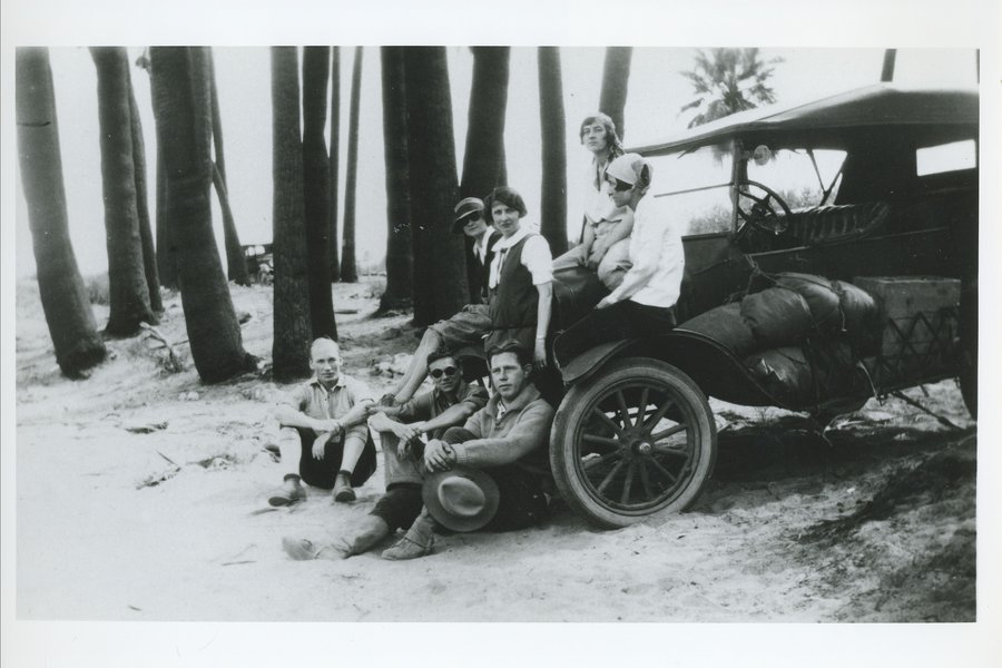 Arnold and Mabel on car with friends.jpg